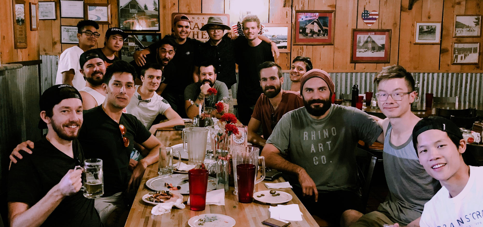 Photo of a bunch of guys sitting in a restaurant having some beer after a meal